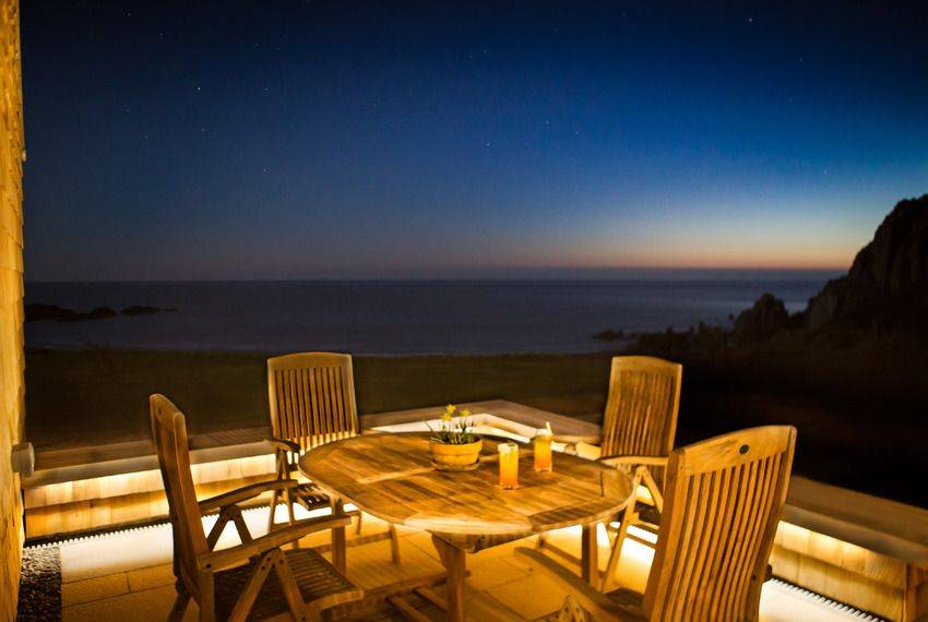 Al fresco dining from the private patio with spectacular sea views